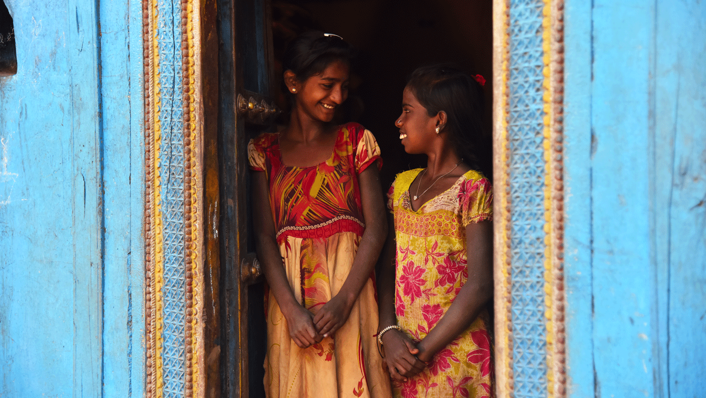 Two girls smiling in doorway