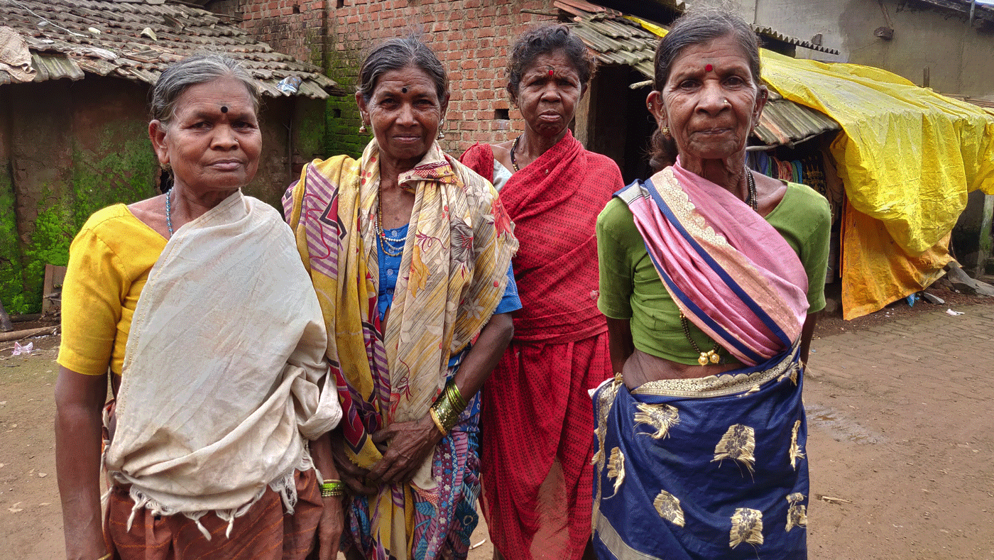 Four old women standing in village
