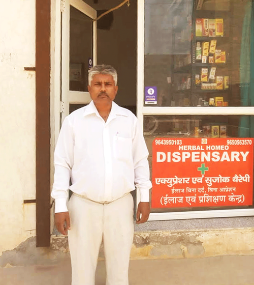 Man poses in front of a dispensary