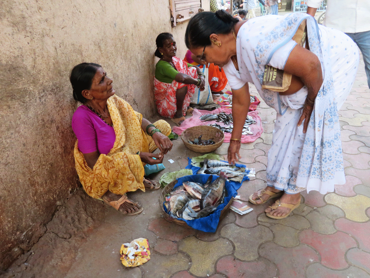 Old lady selling fishes