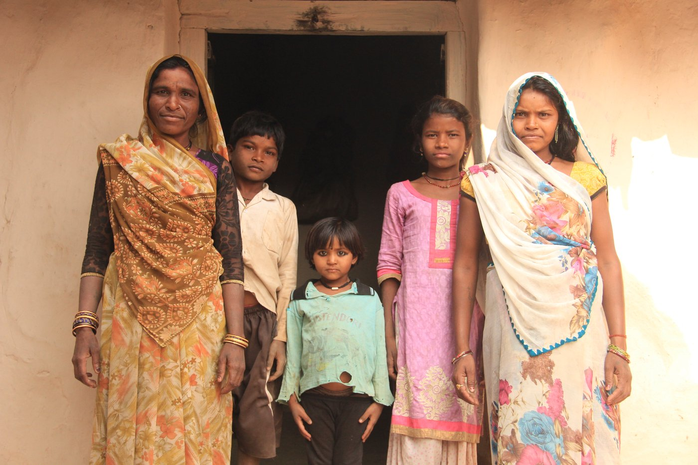 A family standing in front of their house