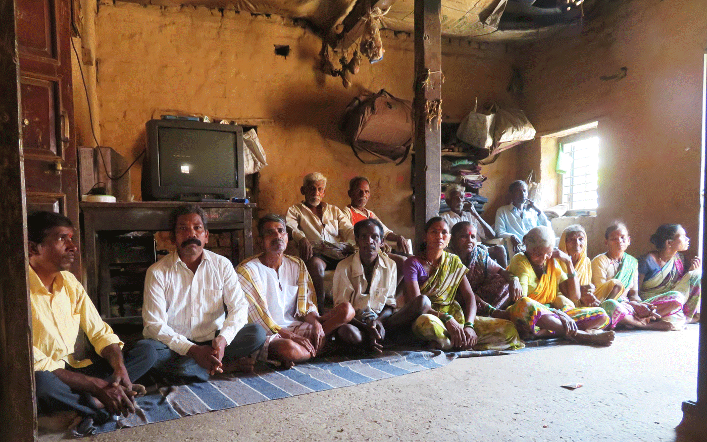 Group of villagers discuss upcoming elections