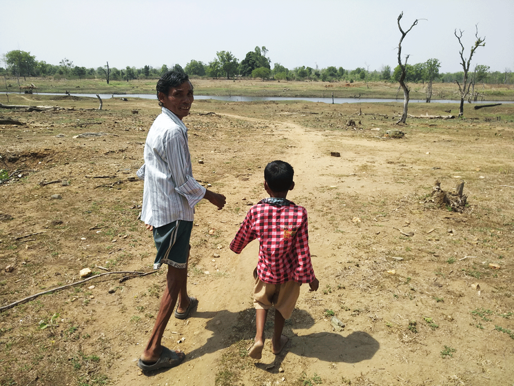 Beersingh's father-in-law Babulal Atram and elder son Vivek in Pindkapar village, which is located along the backwaters of Nagpur district's Bawanthadi dam, around which are the forests adjoining the Pench tiger reserve