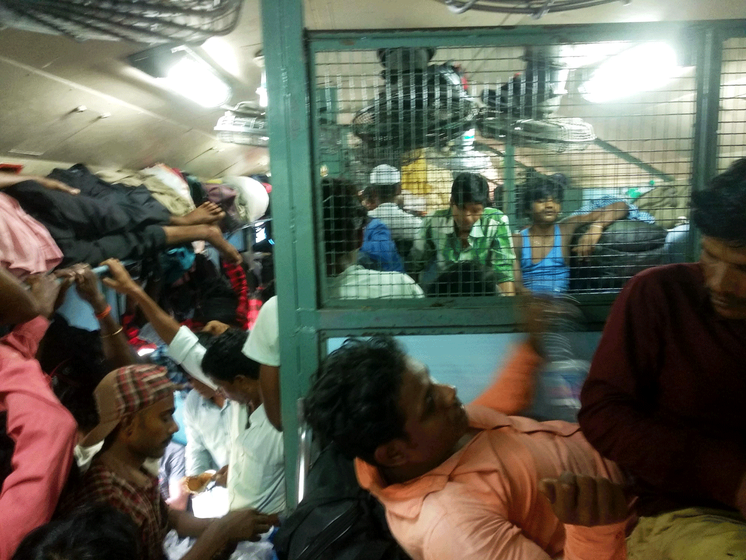 People cramped in train