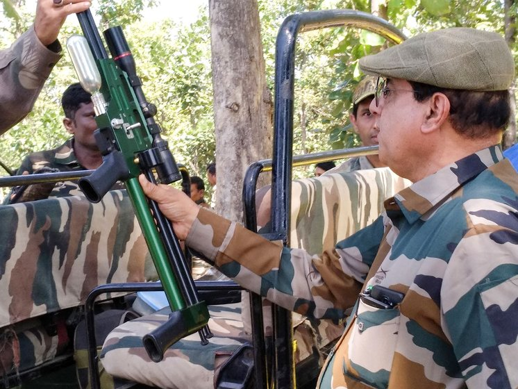 Shafath Ali (left, with the green dart gun) and his team leaving in their patrolling jeep from the base camp in Loni to look for T1, a hunt that finally ended on November 2, after two months of daily tracking, and two years of the tigress remaining elusive