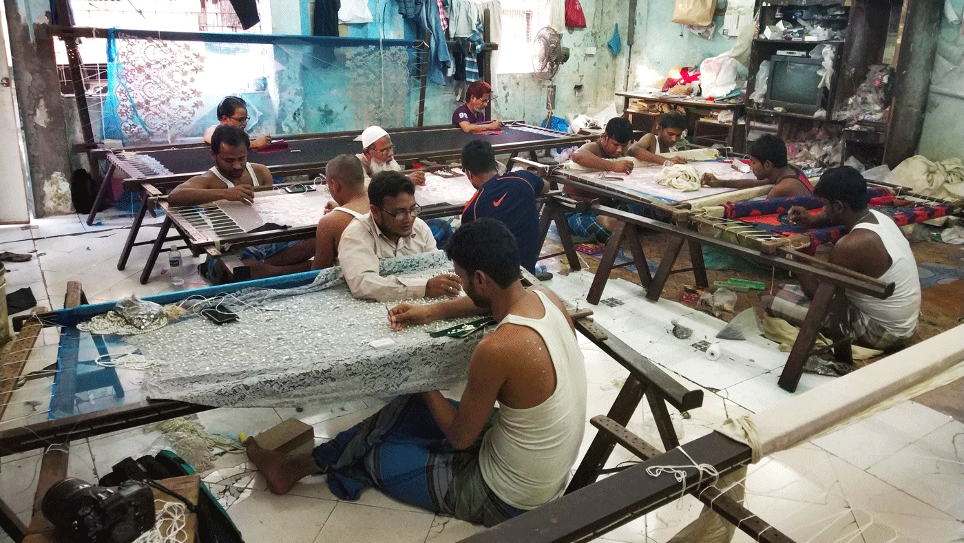 Men working at a zari workshopo