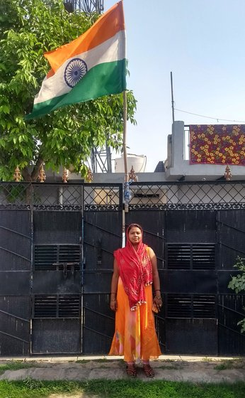 Woman posing by the national flag