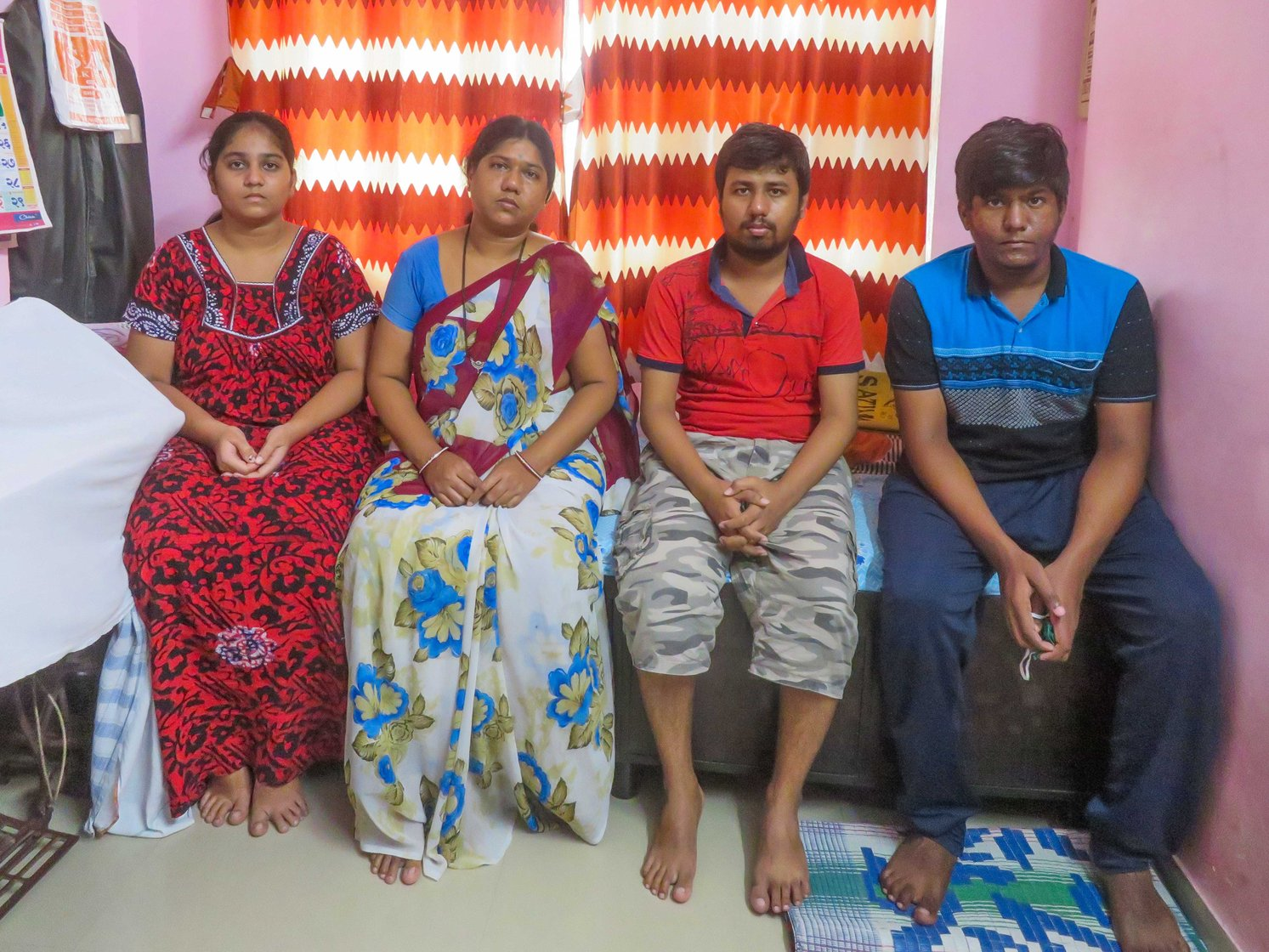 'If he [Ashok] was diagnosed in time, he would have been here', says Sunita, with her kids Manisha (left), Nikesh and Swapnil