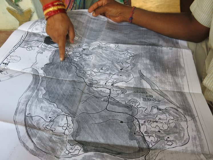 Left: Patrapali sarpanch Sanjukta Sahu with a map of the forestlands which the village has claimed in 2012 under the Forest Rights Act. The administration has still not processed the claim. Centre: Villagers here also have documents from 2012 for filing community forest claims. Right: People in Talabira show copies of their written complaint about the forgery of gram sabha resolutions awarding consent for the forest clearance