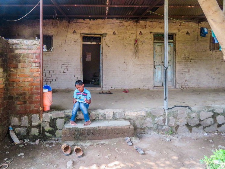 With school shut, Prateek spends his days sitting at the threshold of his one-room mud house, watching a world restricted now to the front yard