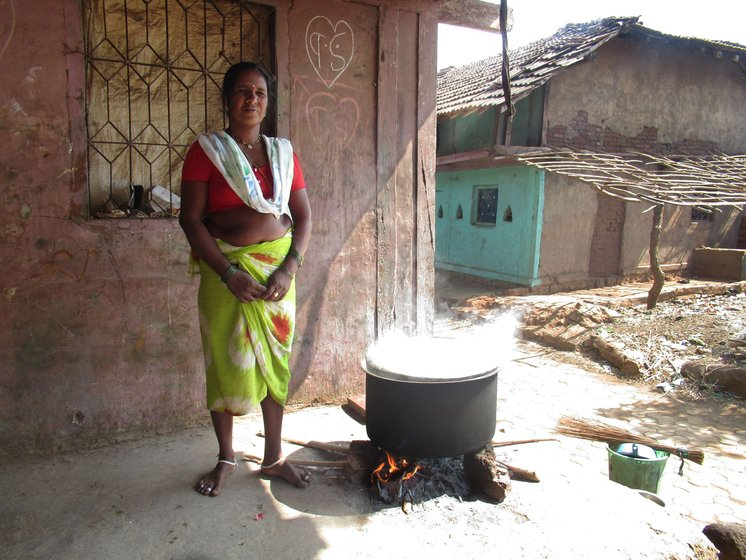Lakshmi Digha cooking outside her house