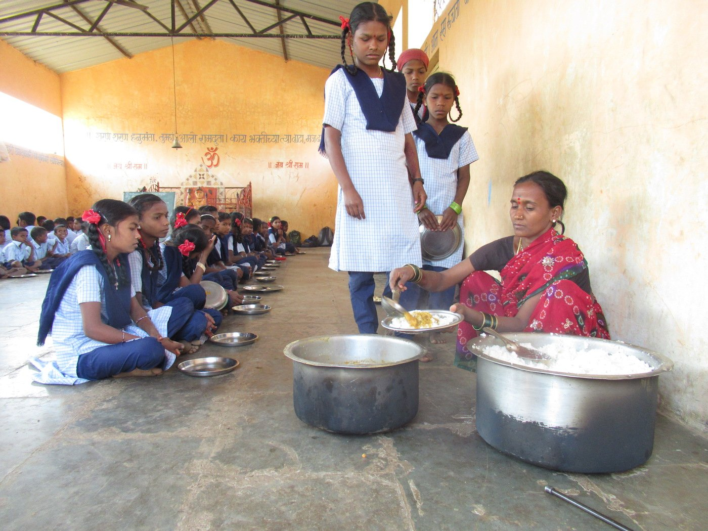 Students wait for their turn while the meal is being served