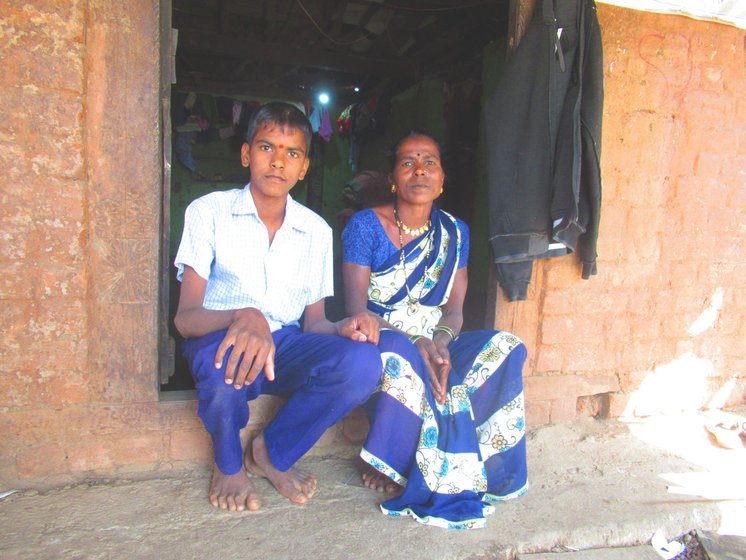 Mangala Burange with her son Sagar seated outside their house