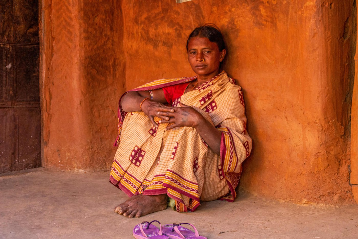 Supari Putel, a daily wage labourer from Odisha's Balangir district, lost her husband and son within four months in 2019, and has since struggled with sorrow, never-receding debt, and an incomplete house