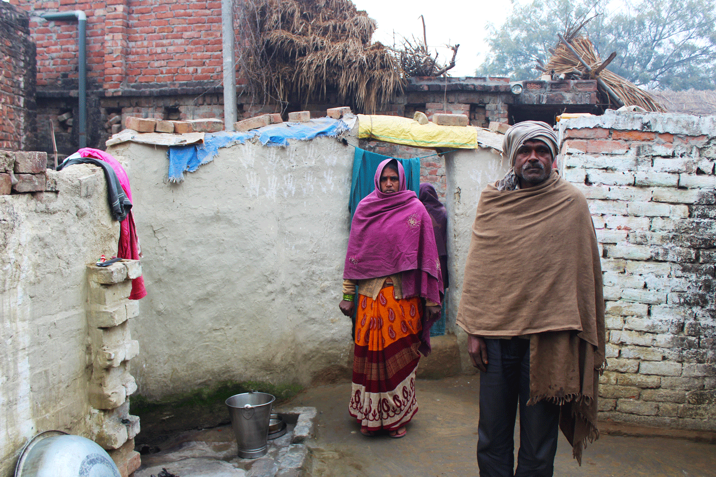Mula and her husband Mangu Lal at their house.