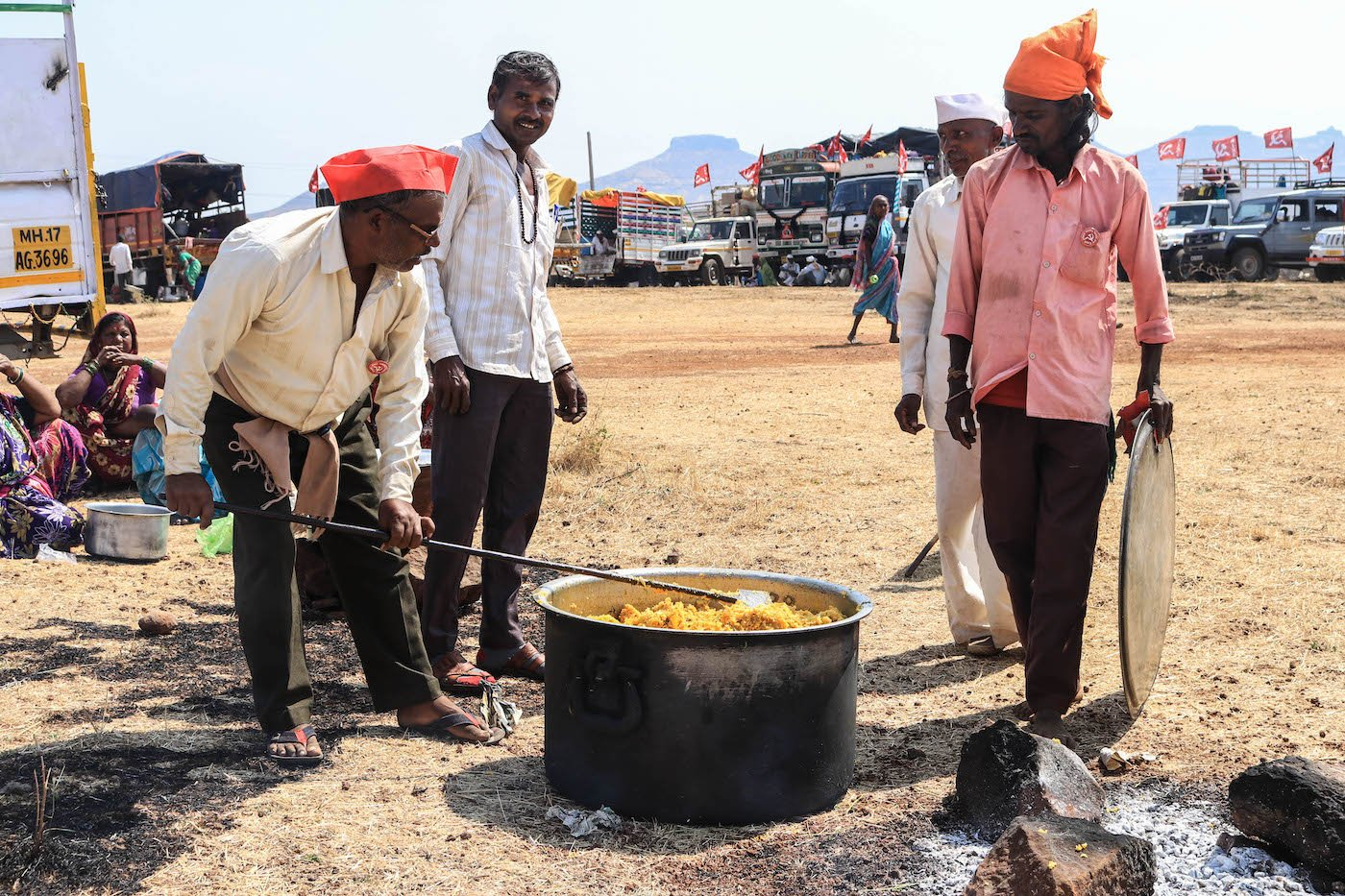 Farmers cooking meal during March