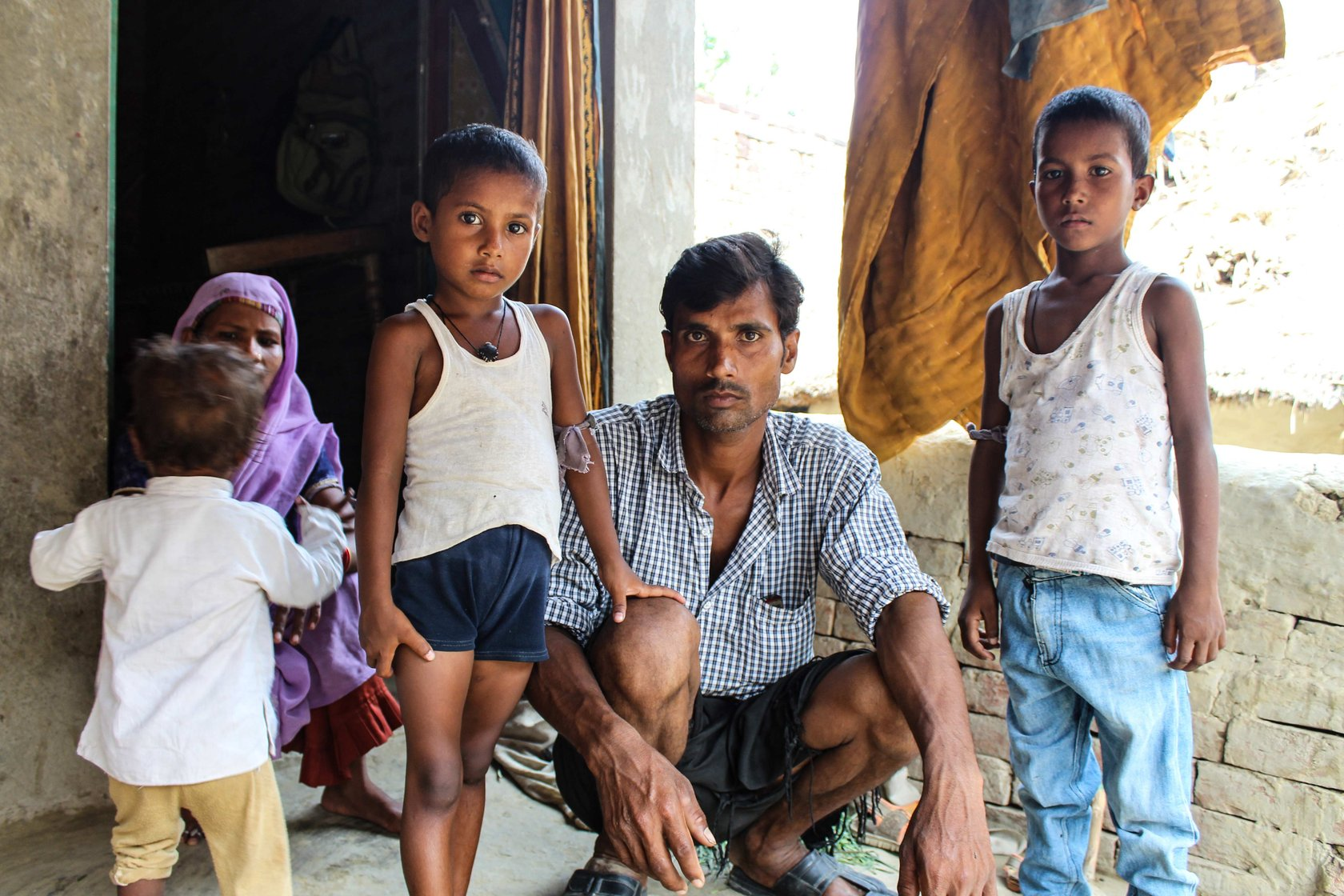 Pramod Kumar, Meenu Devi and their three children outside their house in Dadeora village of Uttar Pradesh