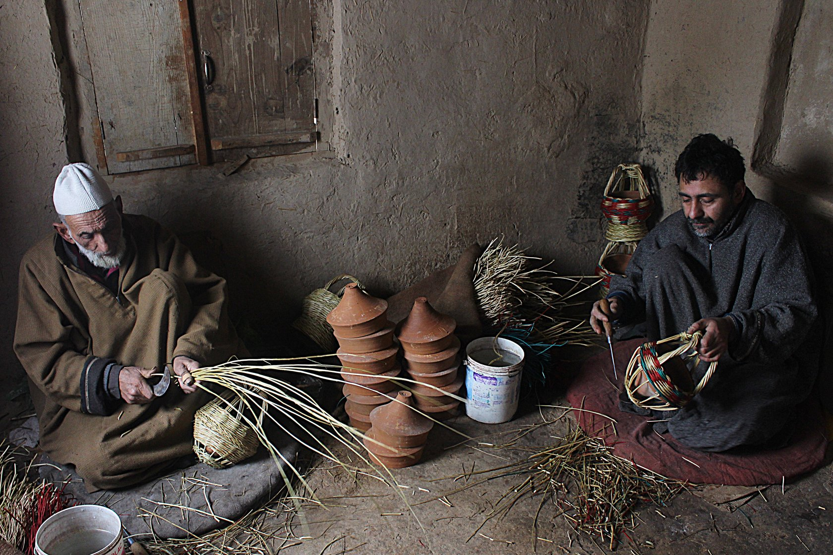 Khazir Mohammad Malik, along with Manzoor Ahmad, weaving kangris at his workshop in Charar-i-Sharief