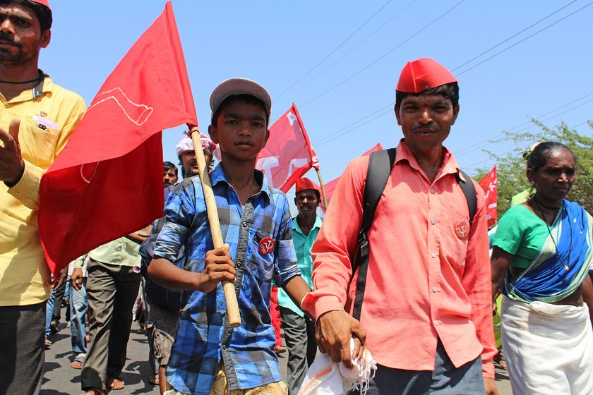 father and son at the farmers' rally