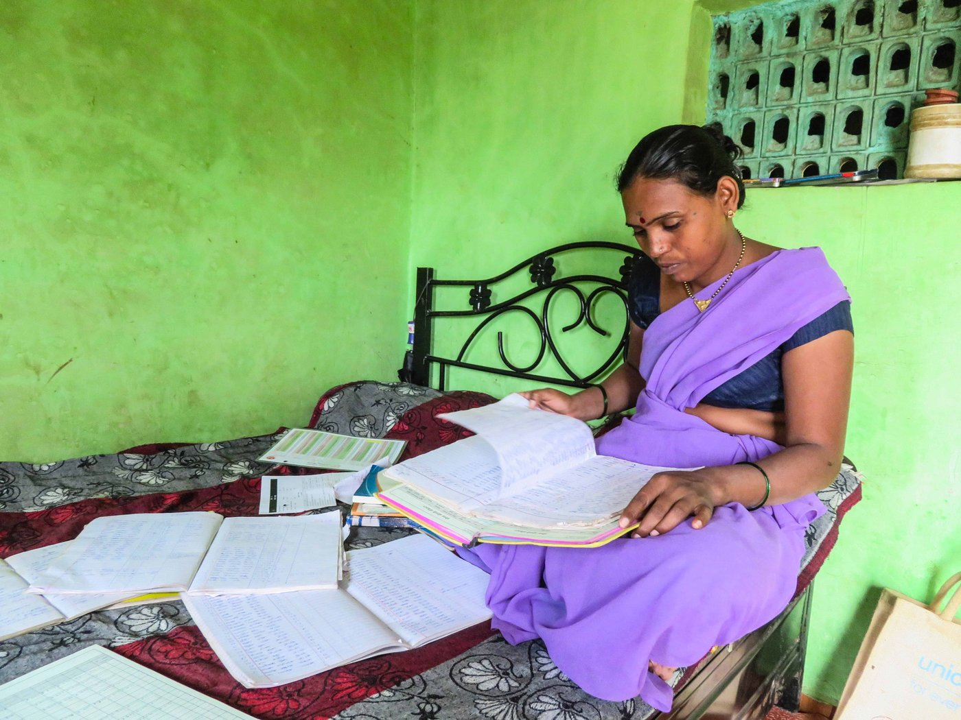 Chandrakala Gangurde going through paper works.