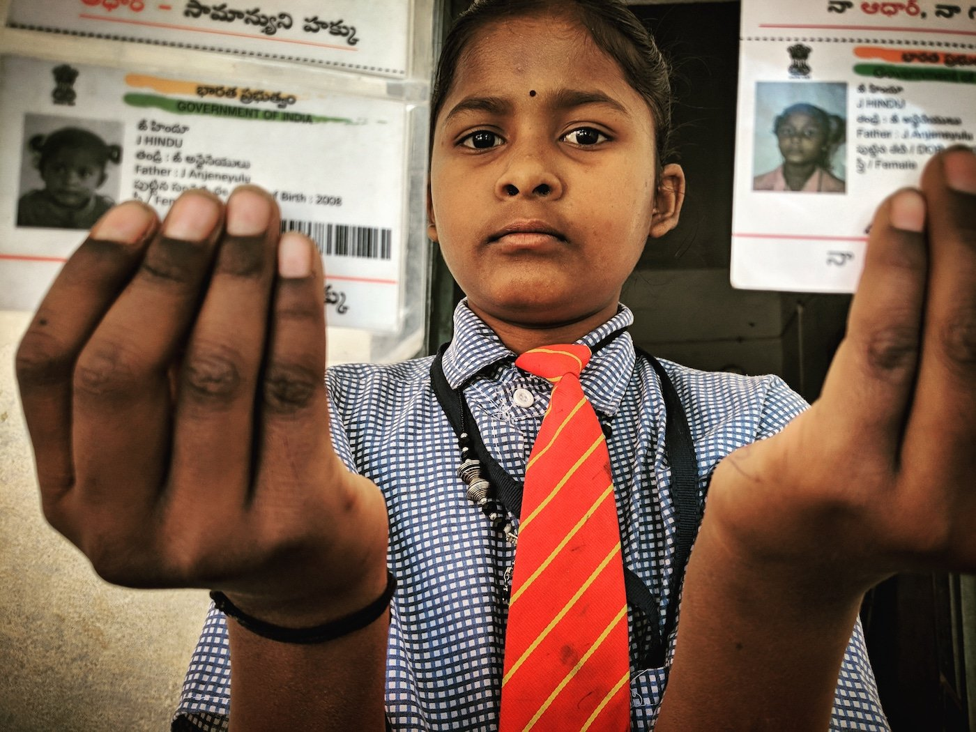 Girl shows Aadhar cards