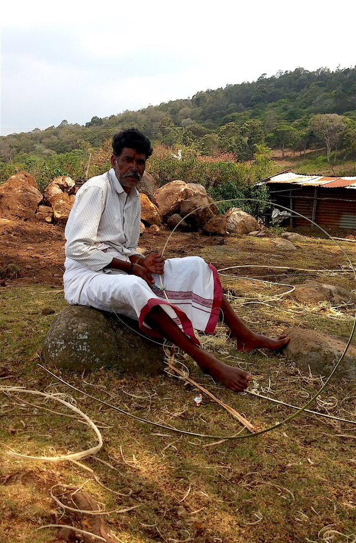 Kathi Kuttan making bamboo strips for a new temple in his Toda village