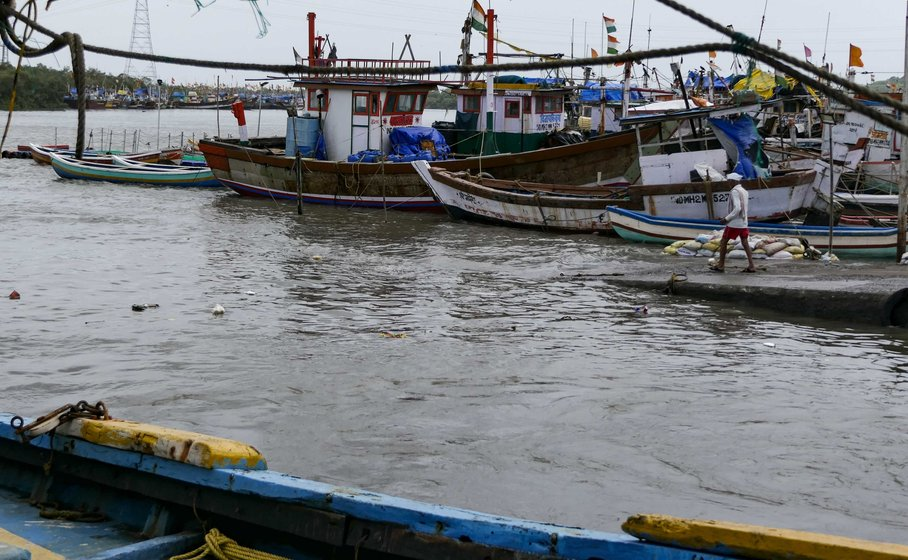 Left: Struggling against a changing tide – fishermen at work at the koliwada. Right: With the fish all but gone from Malad creek and the nearby shorelines, the fishermen of Versova Koliwada have been forced to go deeper into the sea