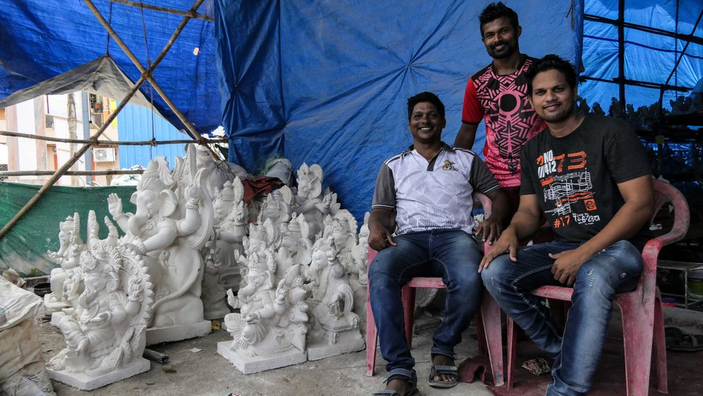 Left: Dinesh Dhanga (on the right right) heads an organisation of around 250 fishermen operating small boats; its members include Sunil Kapatil (left) and Rakesh Sukacha (centre). Dinesh and Sunil now have a Ganapati idol-making workshop to supplement their dwindling income from fishing