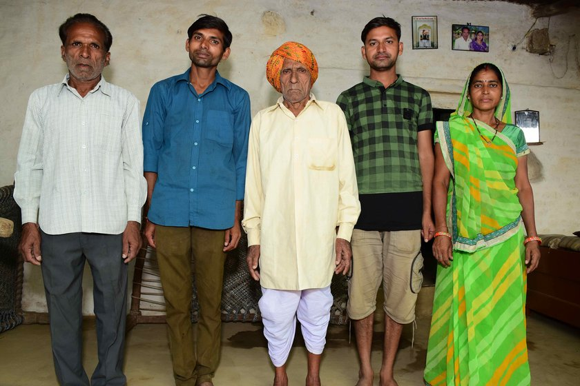 Left: Sukhlal Suliya with his family (left to right): son Badri, Badri's sons Deepak and Vijay, and Badri's wife Devaki. Right: With a few of his 17 grandchildren