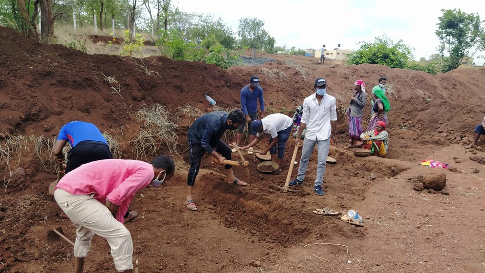 Atish Metre (right), who has completed his MBA coursework, also went to work at MGNREGA sites in Kamthana village in Karnataka