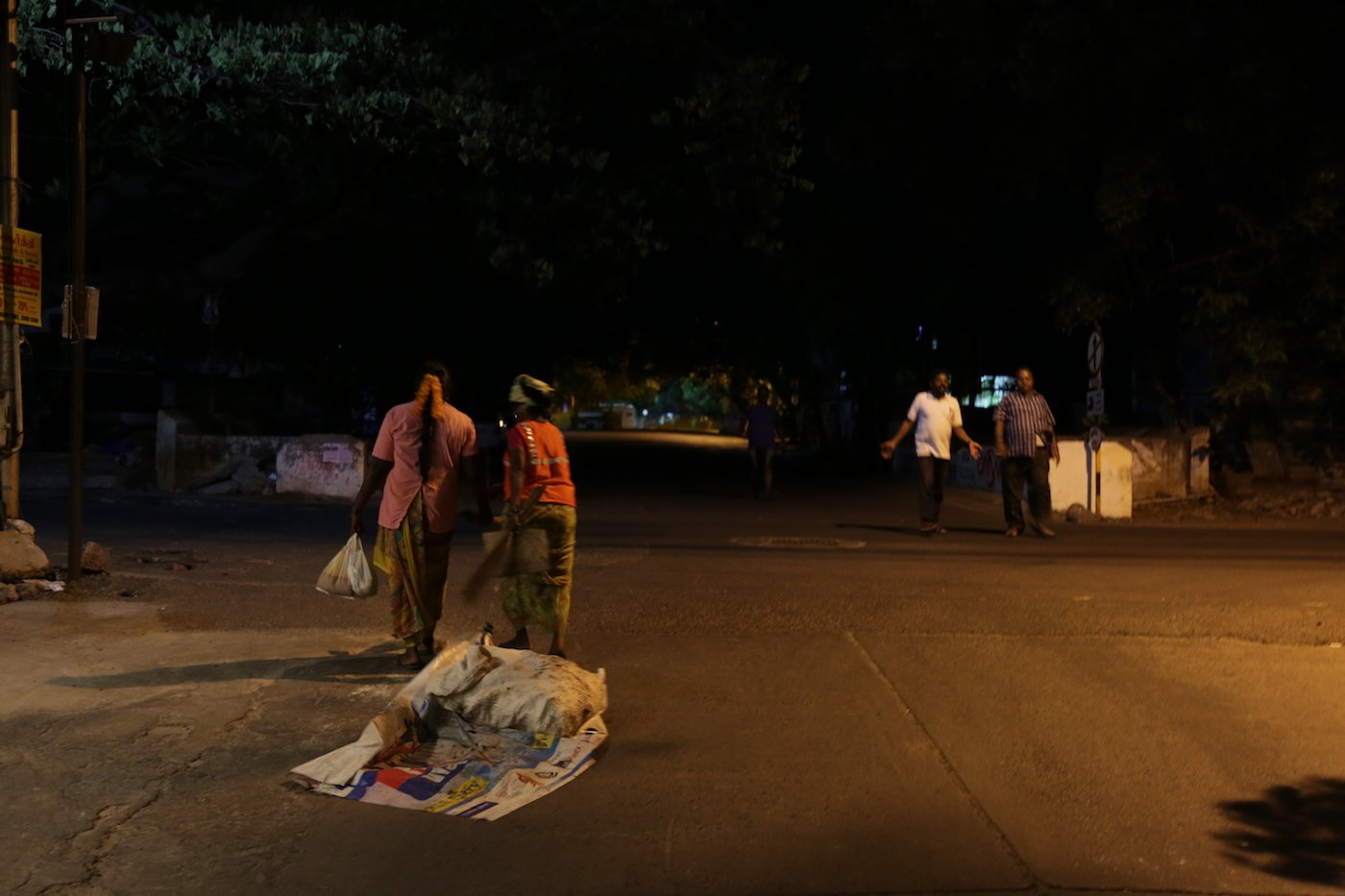 With just a few passers-by on the road at this late hour, they continue to quietly work to keep White Town clean