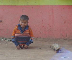 A child sitting and  smiling