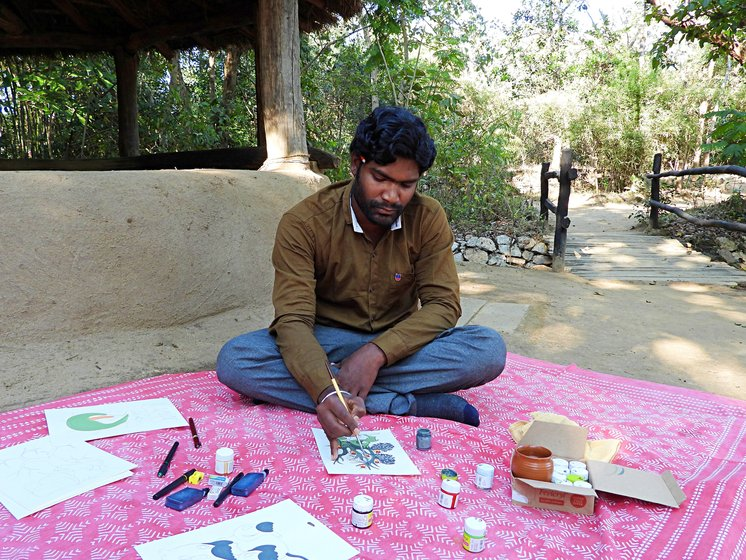 Mithlesh Kumar Shyam at the wildlife camp where he occasionally displays and sells his paintings. Like other Gond artists, he too has a distinctive style