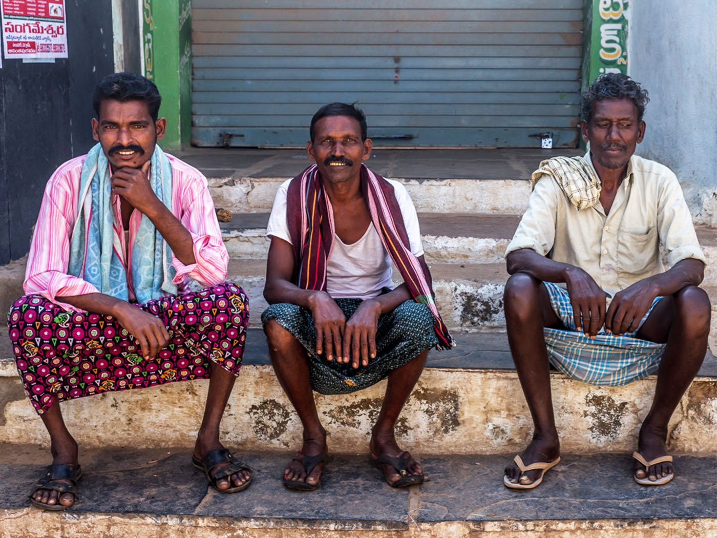 Farmers sitting in front of local shop