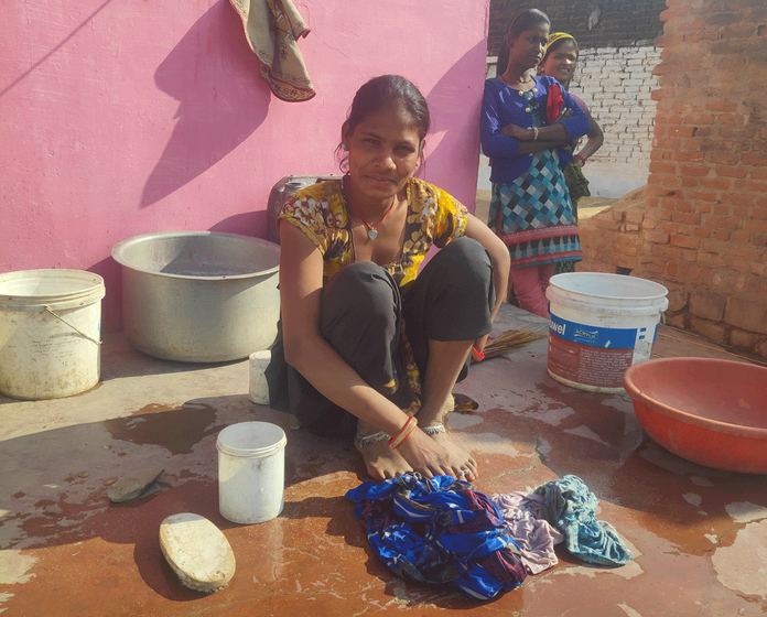 Sandhya doing household chores