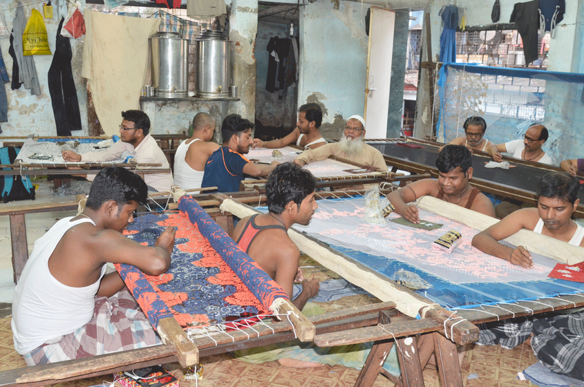 Weavers working