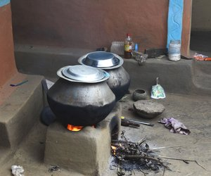Food being cooked on earthen stove