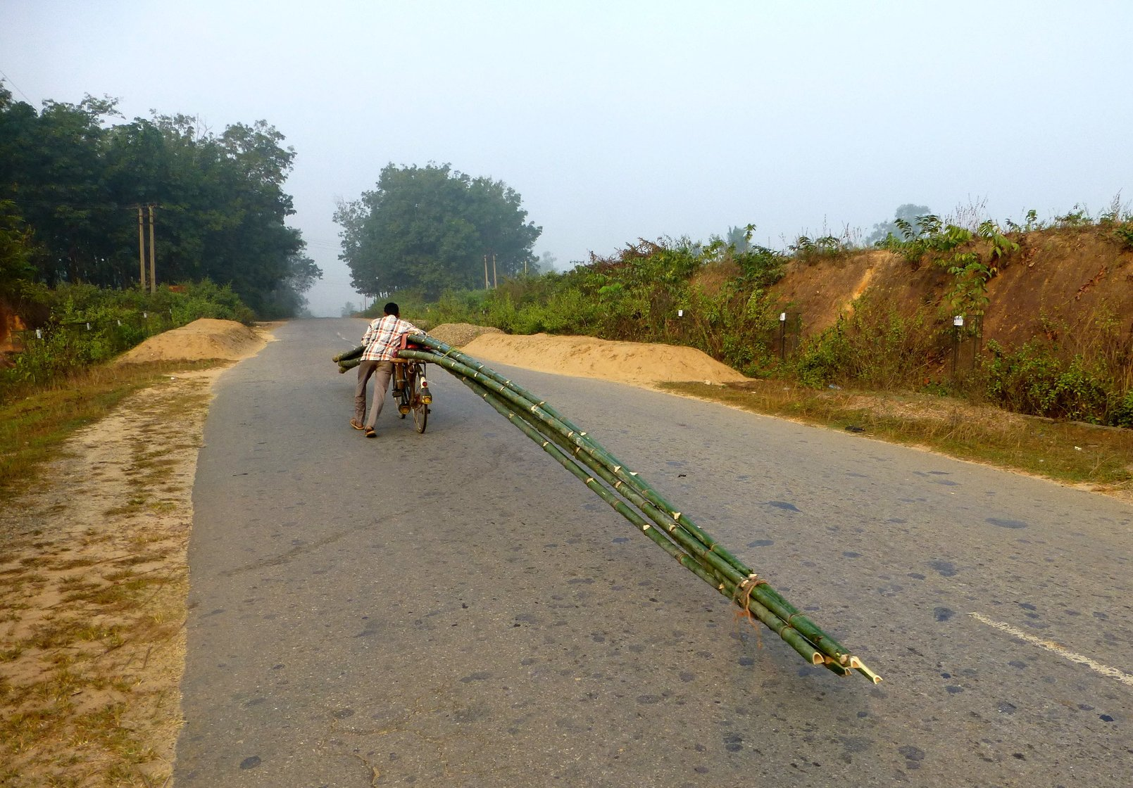 Biswas pushes off in the opposite direction, his bicycle's 40-feet tail wagging gently behind him