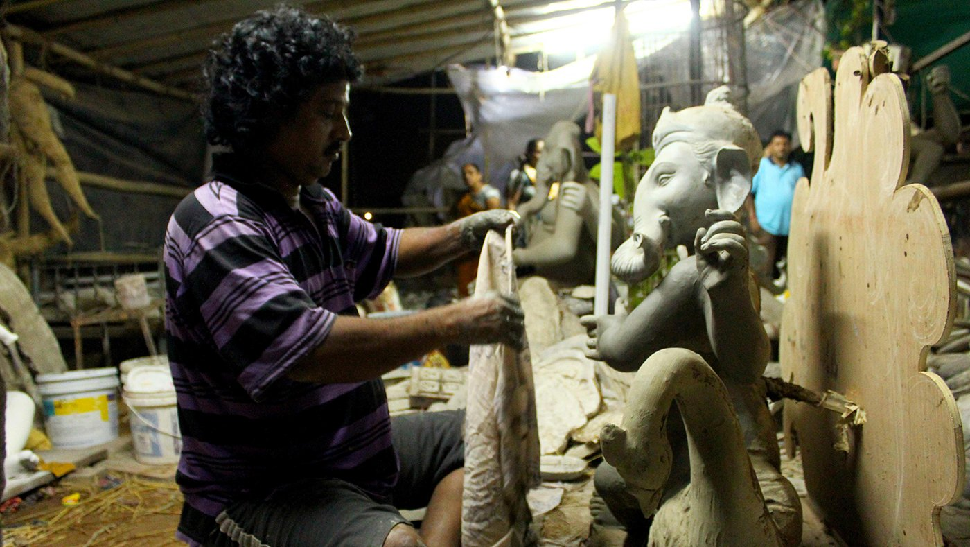 Artist making ganpati idol