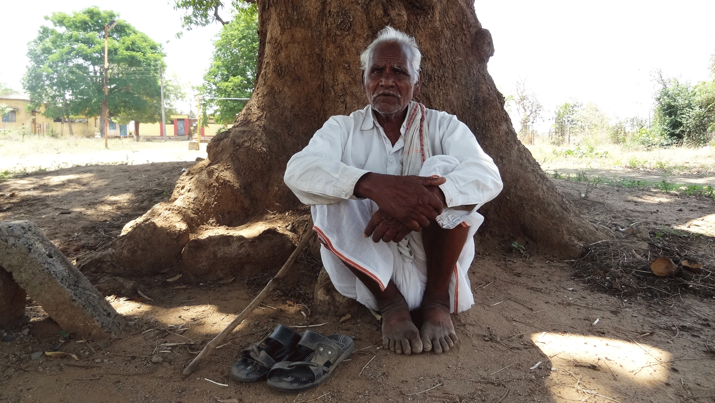 Mahadev Kamble sitting in a shade.