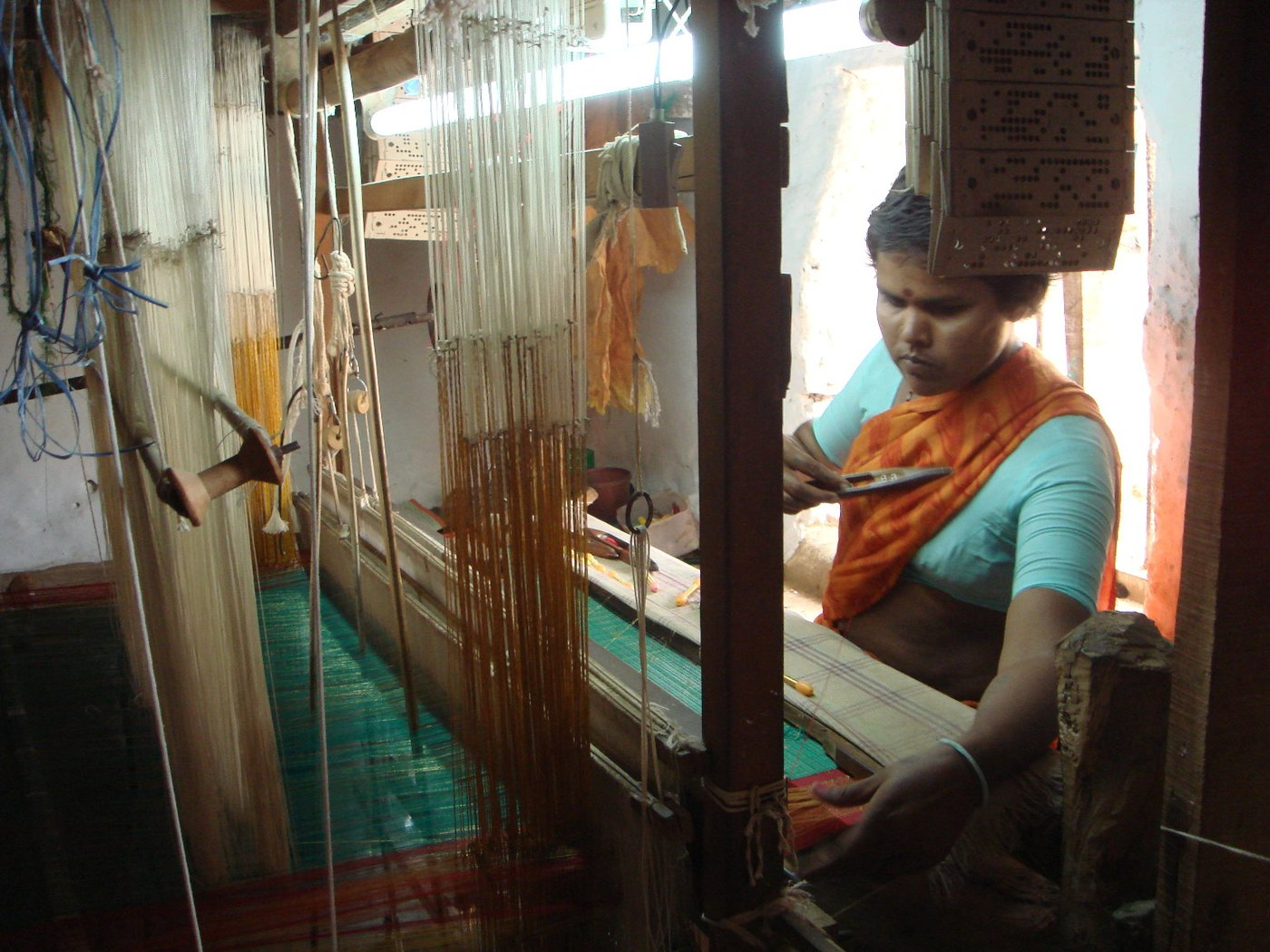 Woman weaving saree on handloom