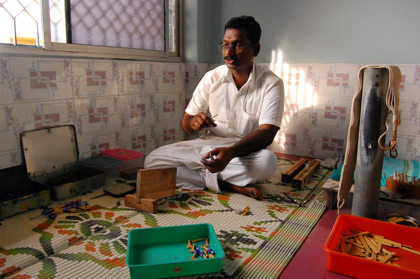 Man making Seevali, a handmade reed mouth-piece to play the Nadaswaram