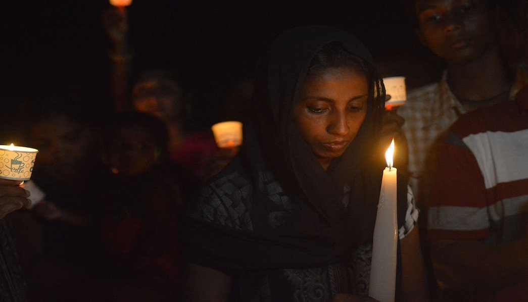 Woman participating in candle march
