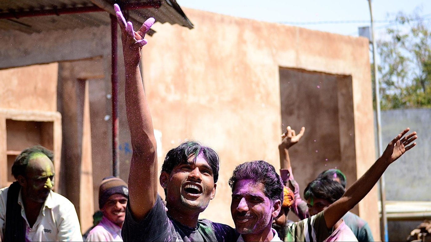Group of people playing Holi