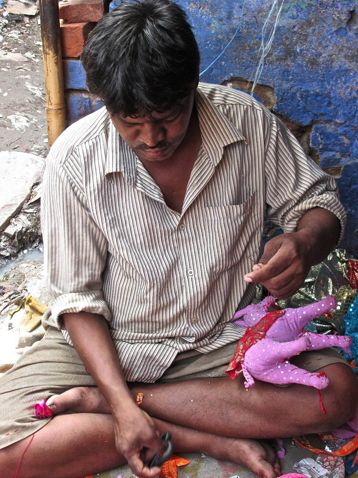 Man making puppets in Delhi's Kathputli Colony