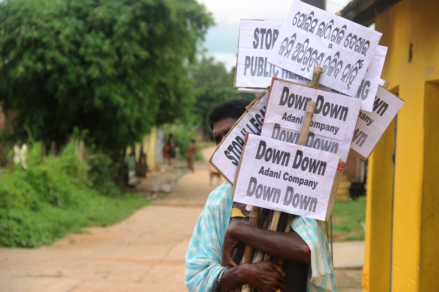 a villager with protest placards