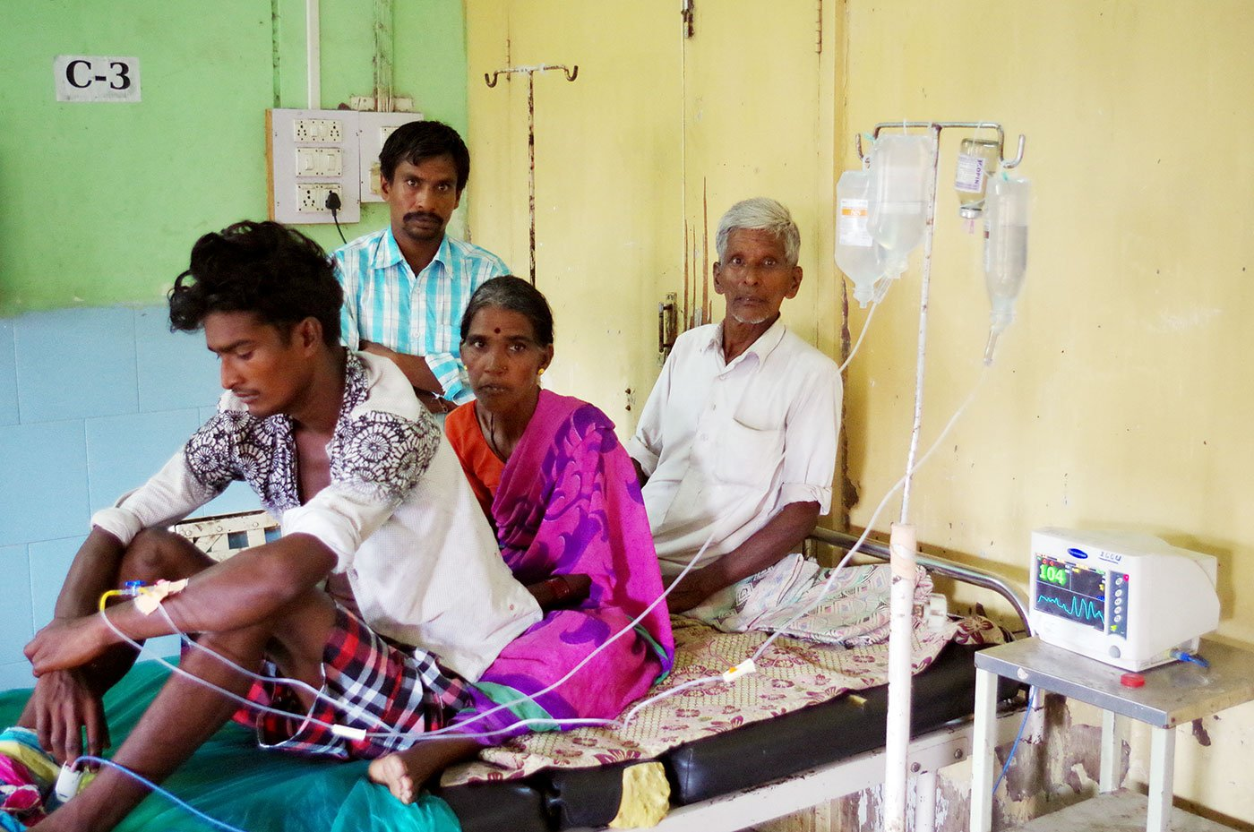 Nikesh Kathane, a 21-year-old farm labourer, recuperating in the ICU of the Yavatmal Government Medical College and Hospital in September 2017, after falling sick in the wake of accidental inhalation of pesticide while spraying it on his owner's field. With him are his parents Keshavrao and Tarabai and his elder brother Laxman