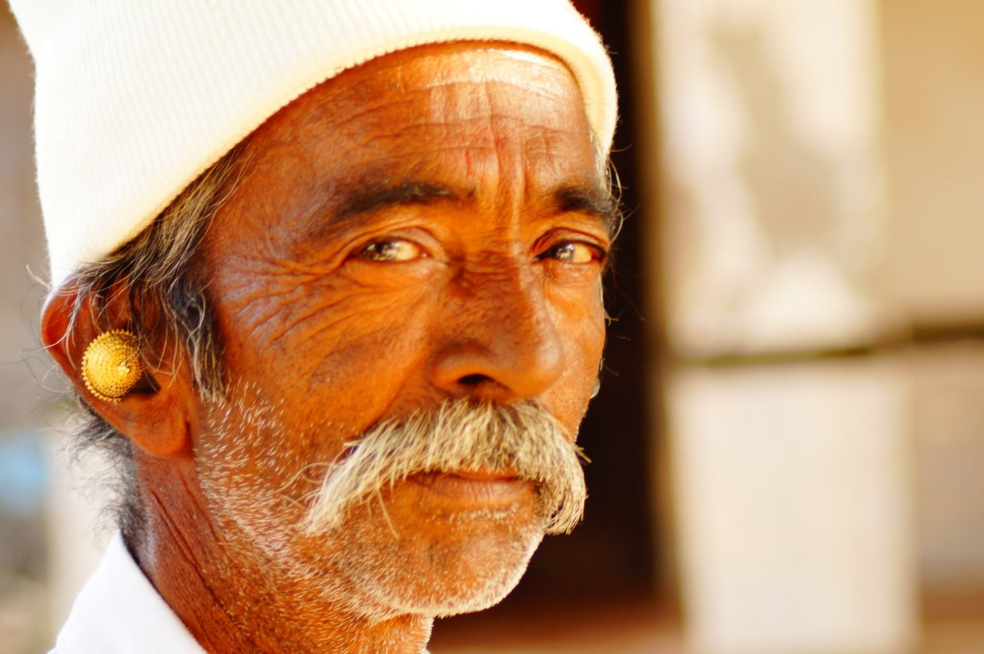 Old man with gold earring