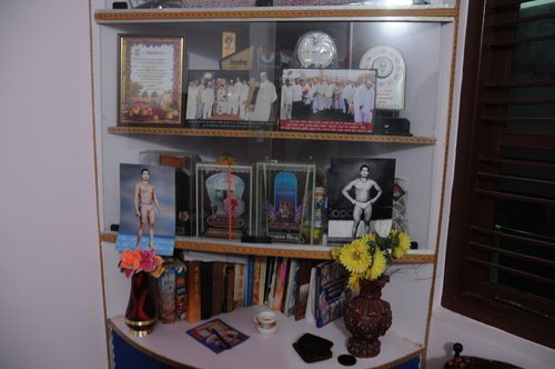 /static/media/uploads/Articles/P. Sainath/Wrestling /pujari's_trophy_case_at_home_dsc_1047.jpg