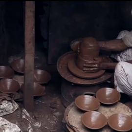 Muslim Man making clay pots